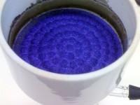 Precipitado azul en un embudo buchner